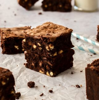 2 chocolate chip brownies stacked on top of one another
