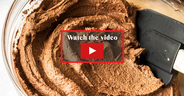 A glass bowl filled with chcolate fudge frosting. This image is a link to the video