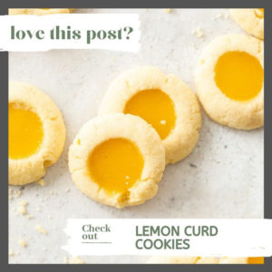 A batch of lemon curd cookies on a sheet of baking paper