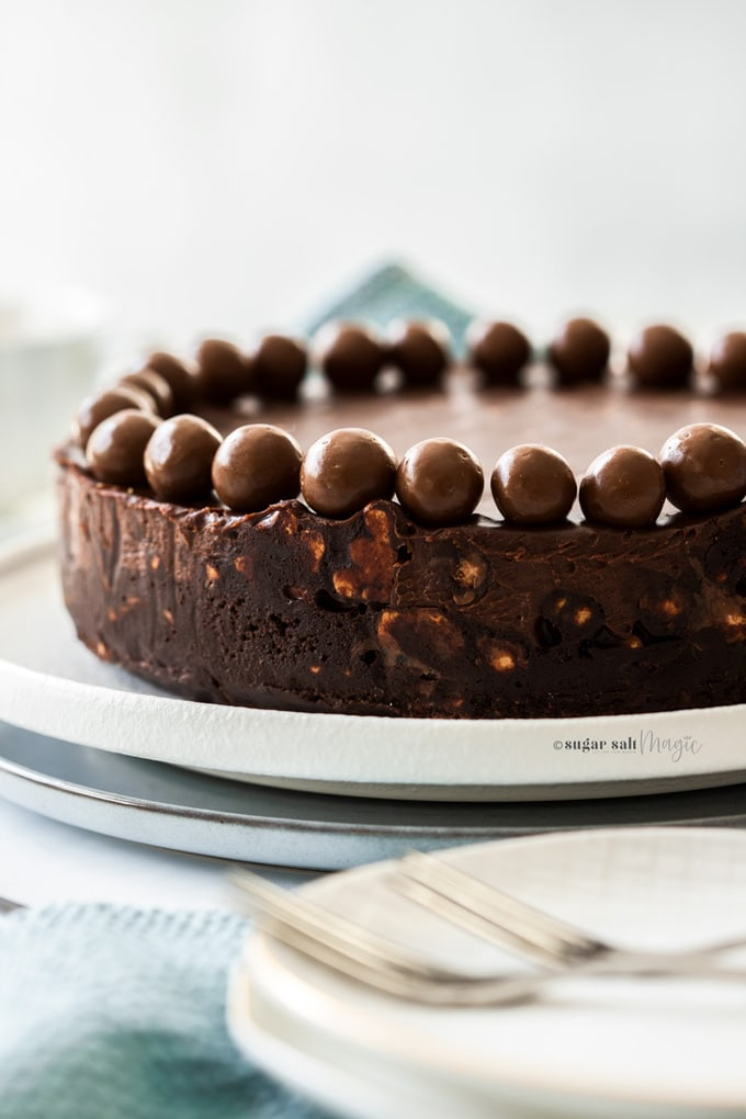 Closeup of the side of a chocolate fridge cake topped with maltesers