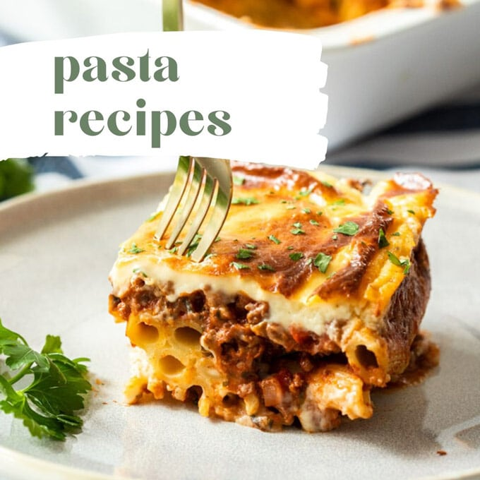 A slice of pastitsio with a fork digging and a title saying pasta recipes