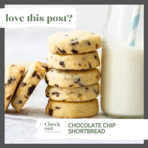 A stack of chocolate chip shortbread leaning up against a bottle of milk
