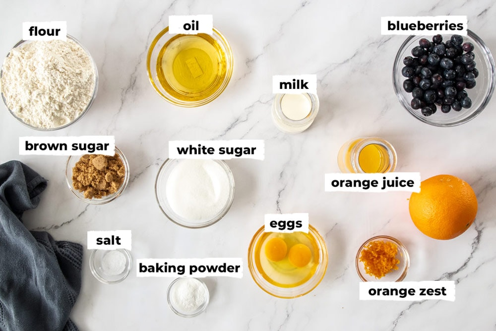 Ingredients for blueberry orange muffins in glass bowls