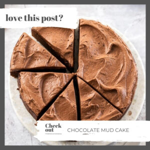 A chocolate mud cake cut into slices on a marble cake plate