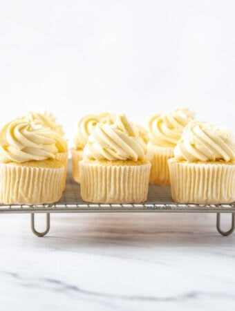A row of 3 cupcakes on a wire rack
