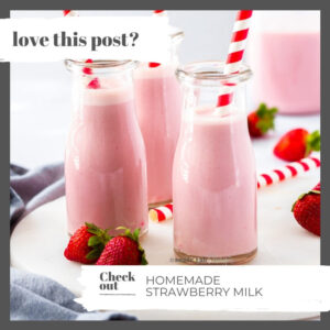 3 bottles of strawberry milk on a marble platter