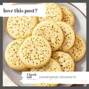 A pile of crumpets on a grey plate