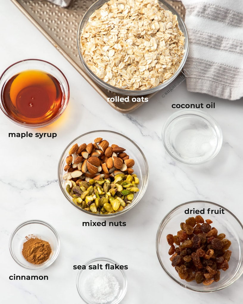 Ingredients for granola in small glass bowls