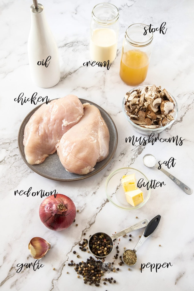 Ingredients for peppercorn chicken laid out on a marble surface