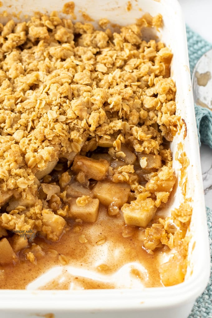 Closeup of apple crumble in a white rectangular dish