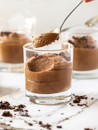 Chocolate mousse in a glass with a spoon taking some out