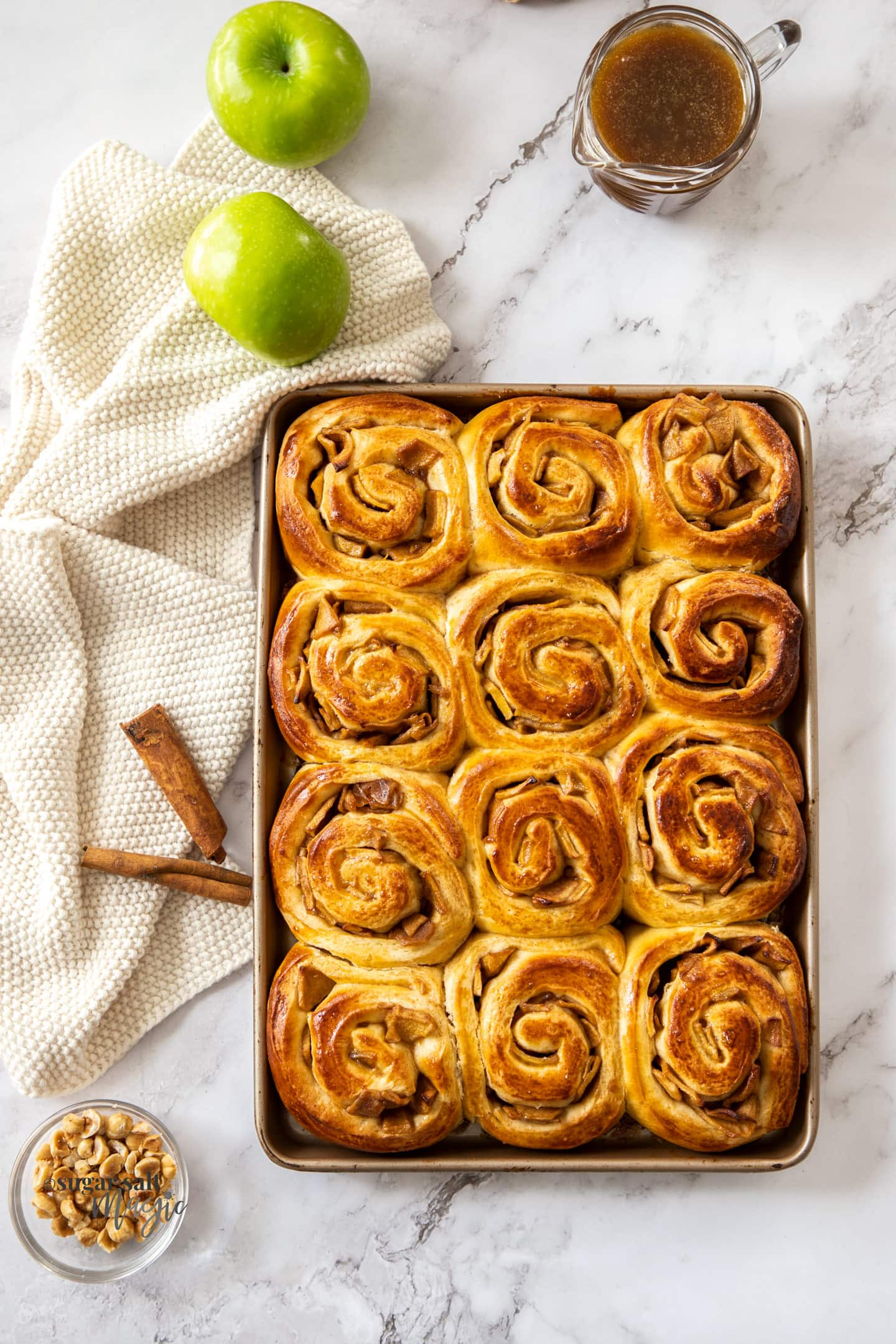 Birdseye view of a tray filled with cinnamon rolls.