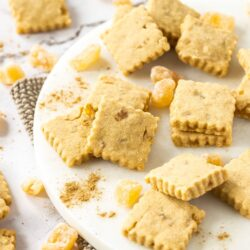 A batch of ginger shortbread surrounded by candied ginger