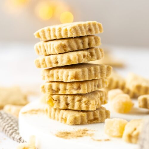A stack of ginger shortbread on a white platter