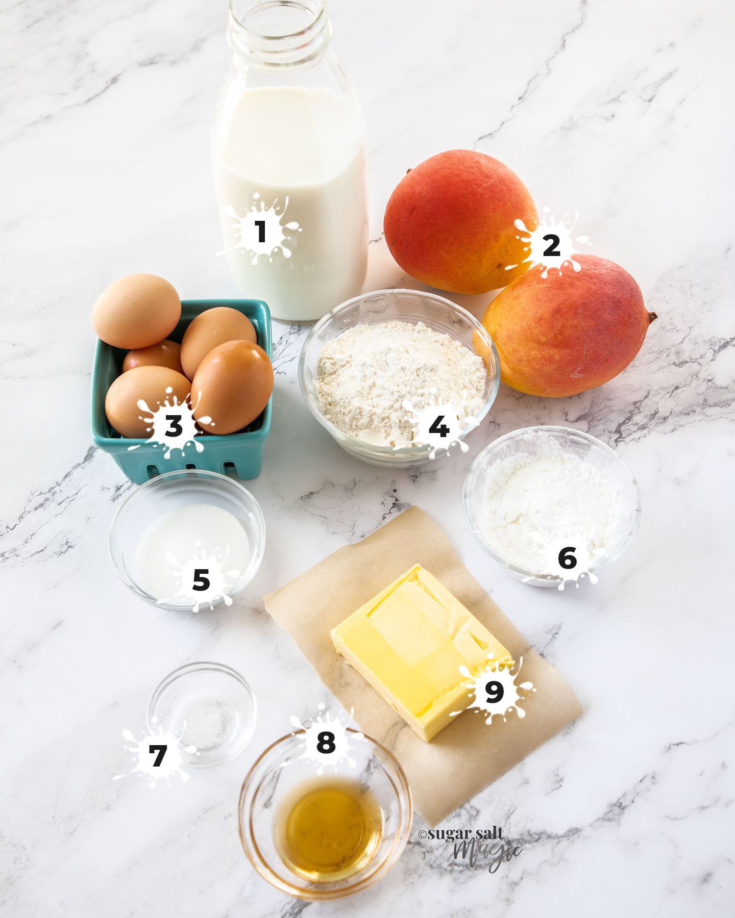 Ingredients for mango tart on a white marble surface