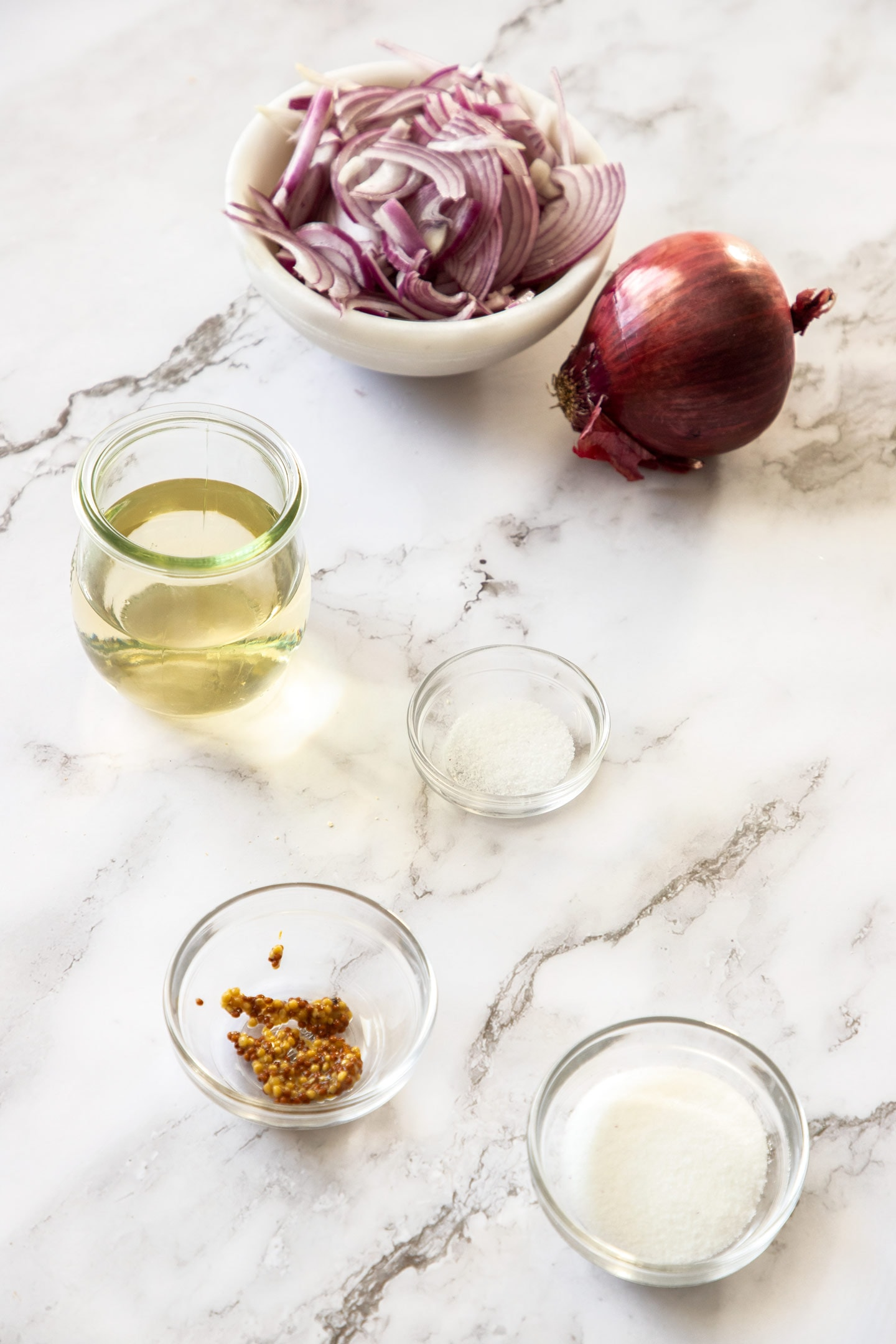 Ingredients for easy pickled onions on a white bench top