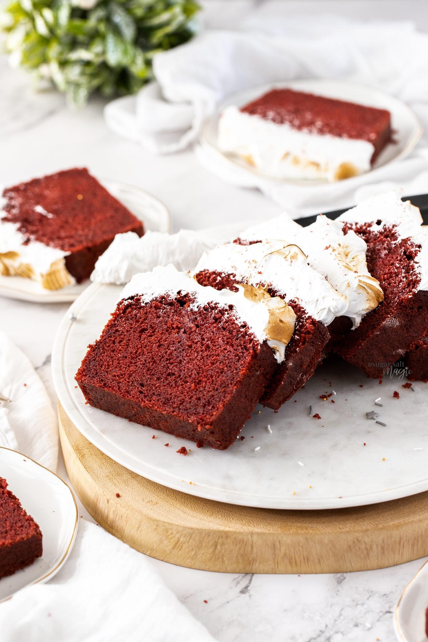 Slices of red velvet pound cake on a white platter