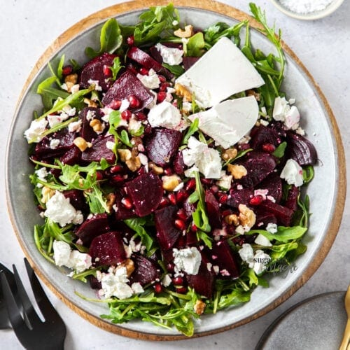 Birdseye view of a salad of beetroot, feta and greens