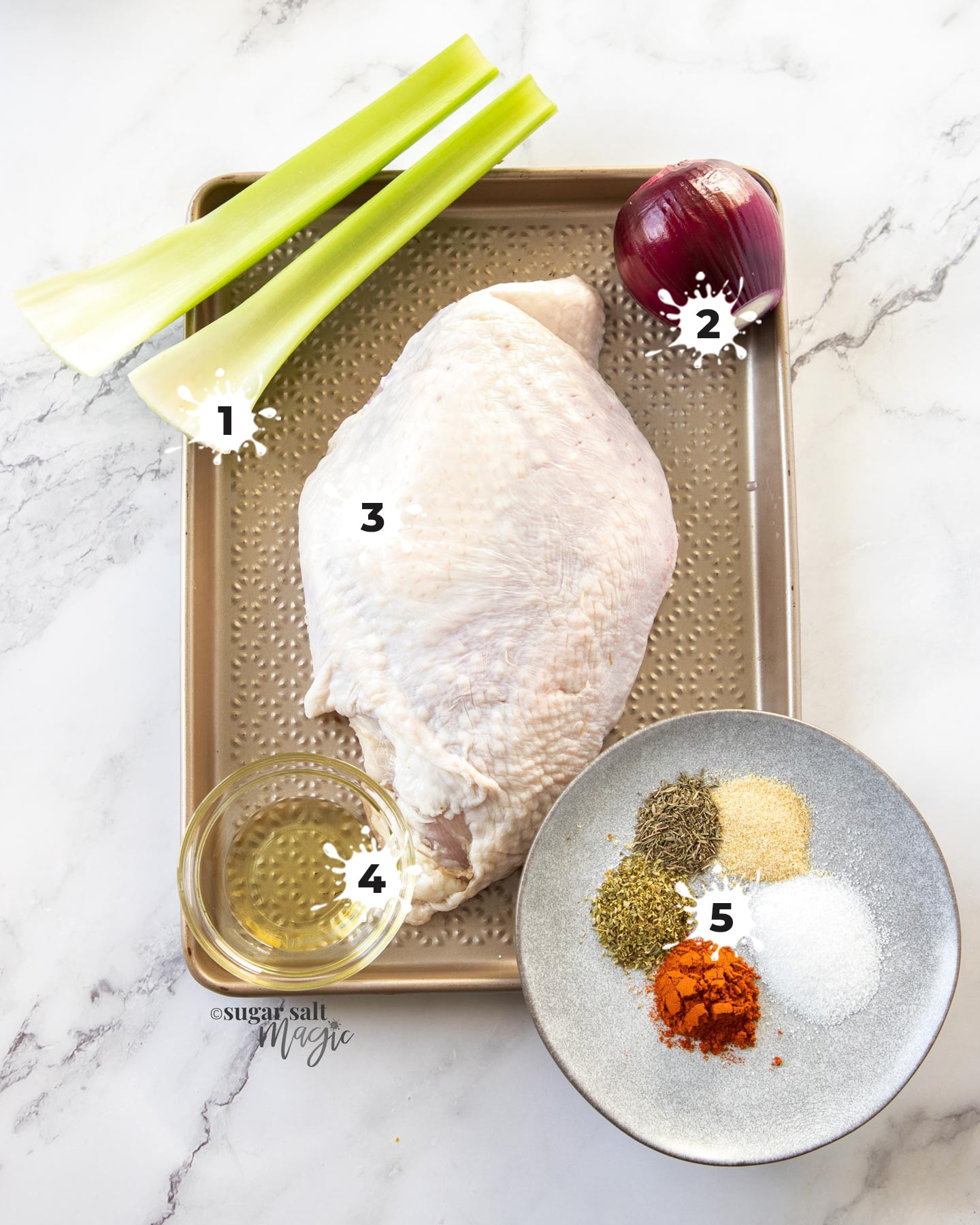 Ingredients for slow cooker turkey breast on a gold baking tray