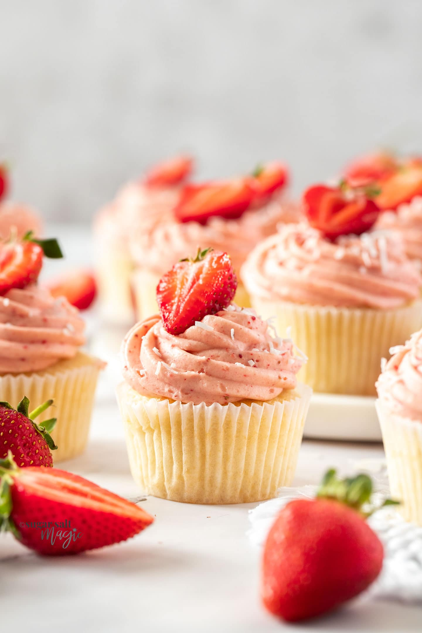 Closeup of a strawberry cupcake with a strawberry on top