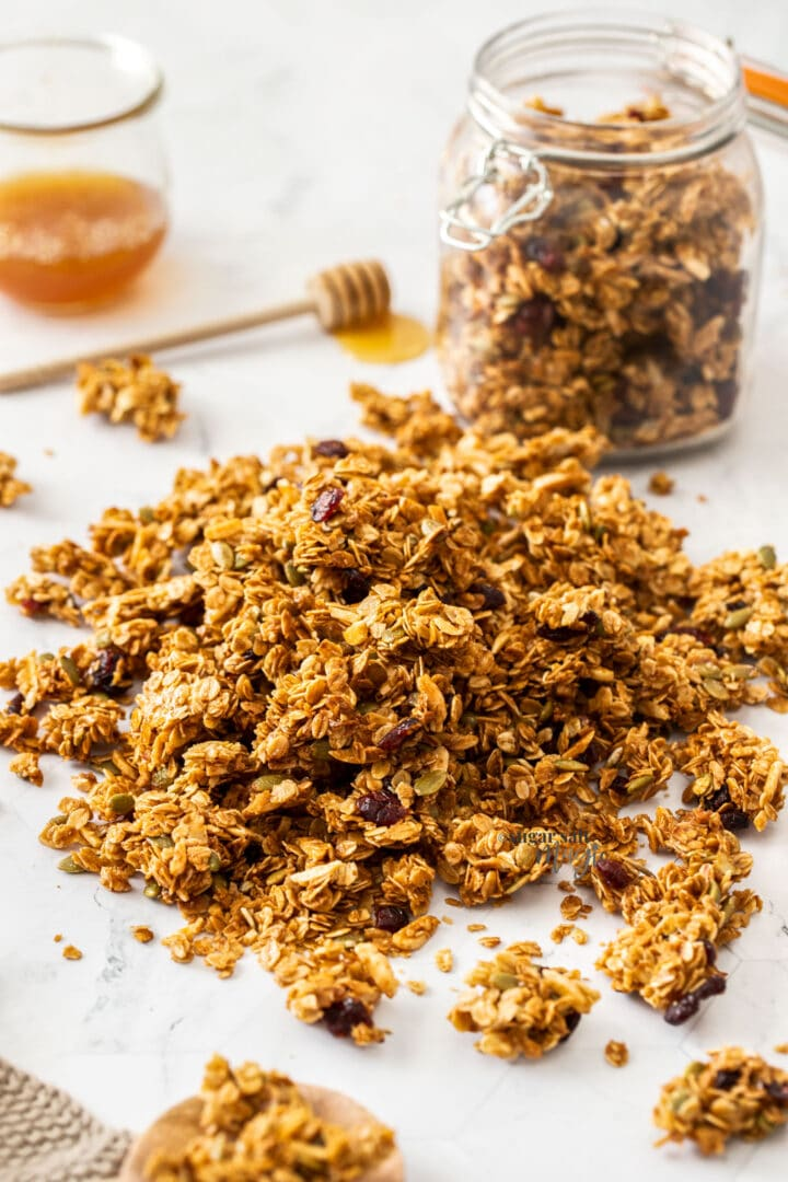 A pile of granola clusters on a white bench top