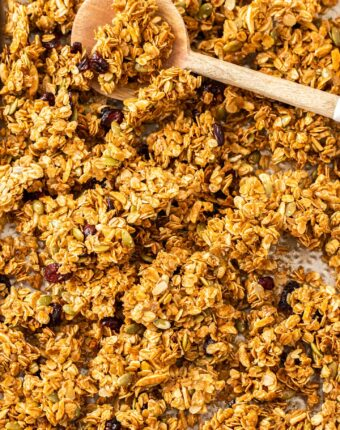 A gold baking tray filled with granola clusters