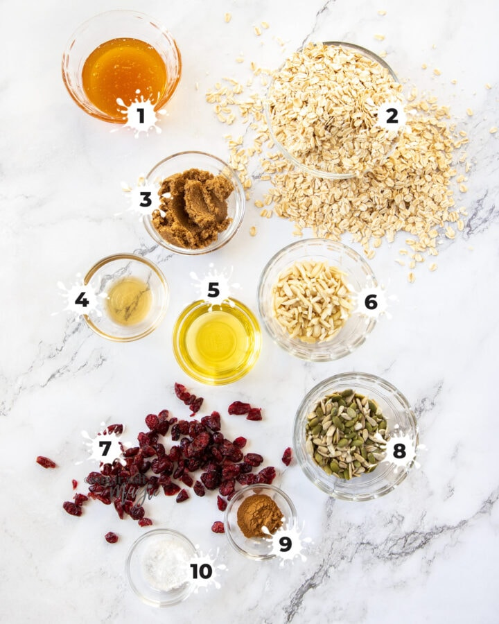 Ingredients for granola on a marble benchtop