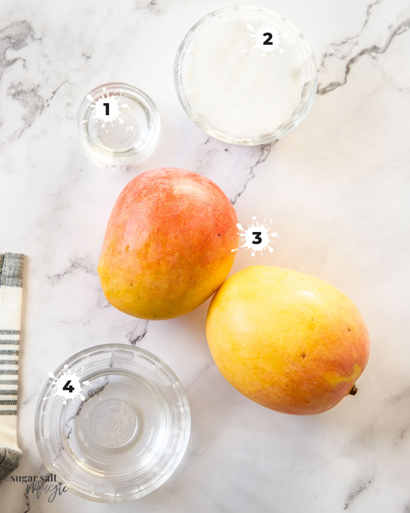 Ingredients fro mango sorbet on a marble surface