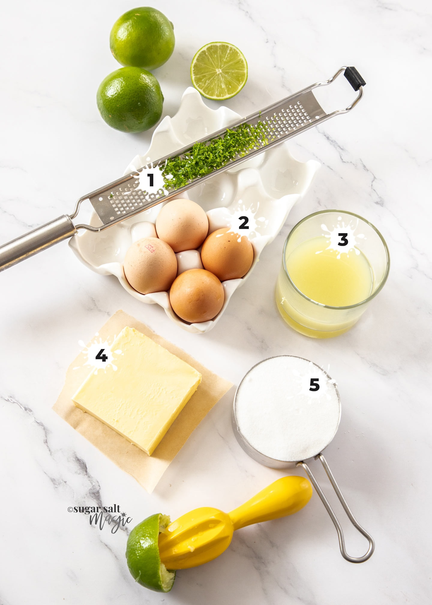 Ingredients for lime curd on a marble surface