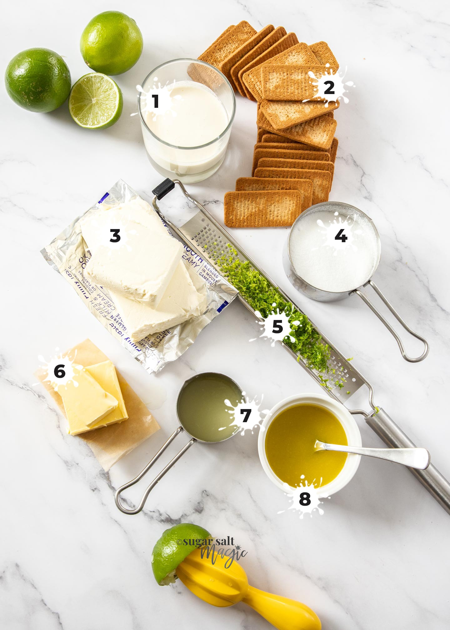 Ingredients for lime cheesecake on a marble surface