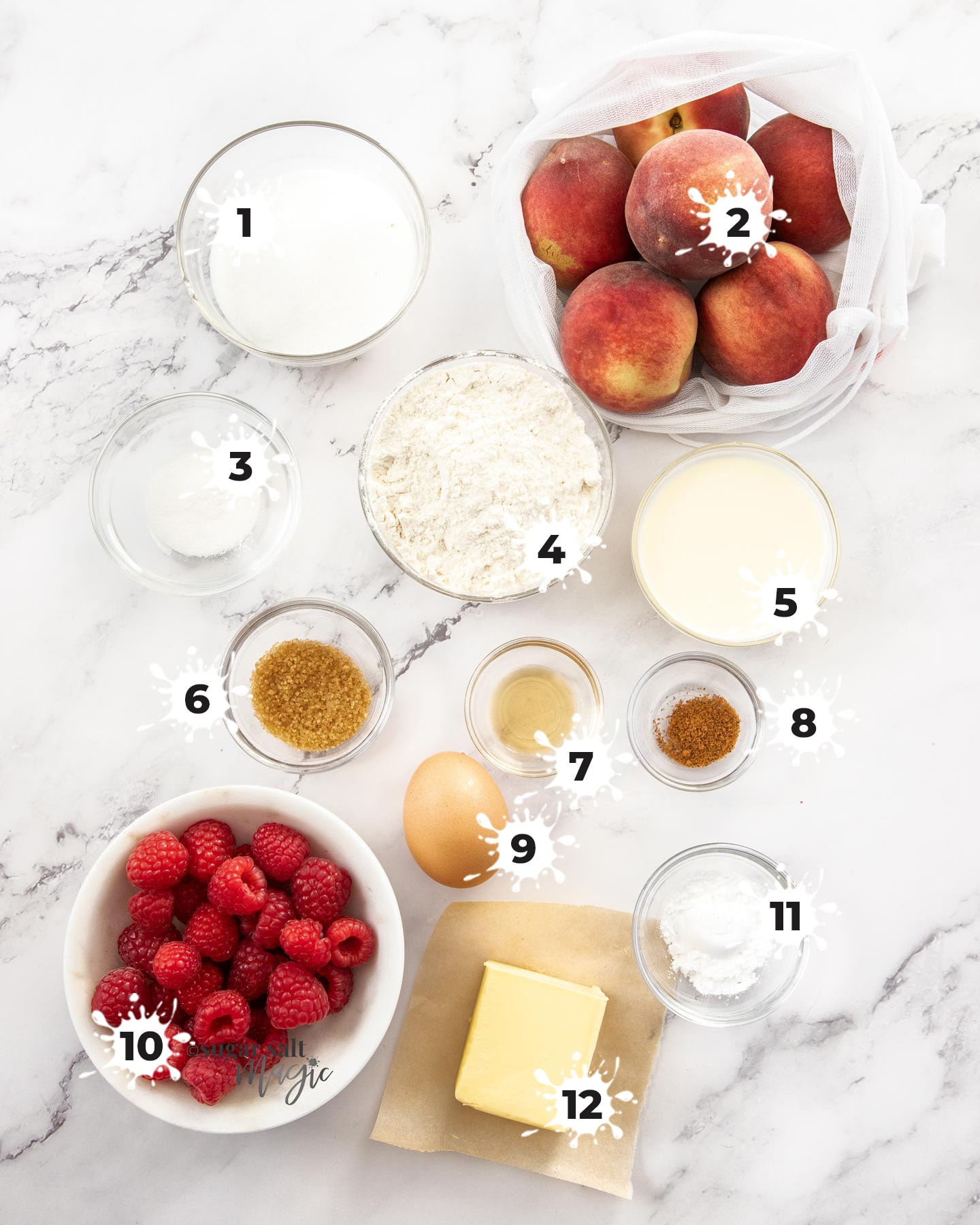 Ingredients for raspberry peach cobbler on a marble surface