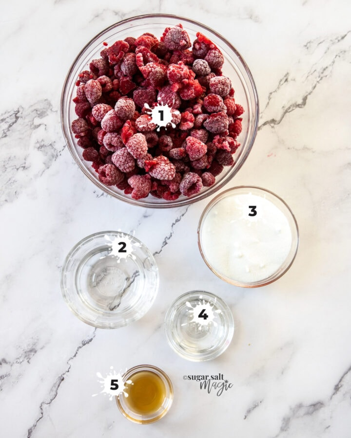 Ingredients for raspberry sorbet on a marble benchtop