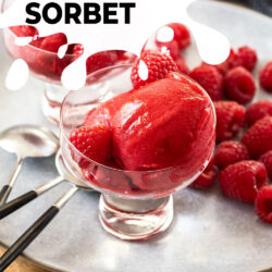 scoops of raspberry sorbet in a a small glass bowl