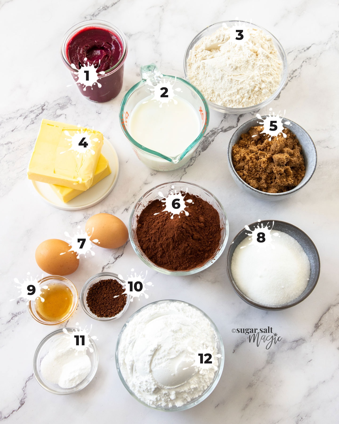 Ingredients for chocolate cake on a marble surface