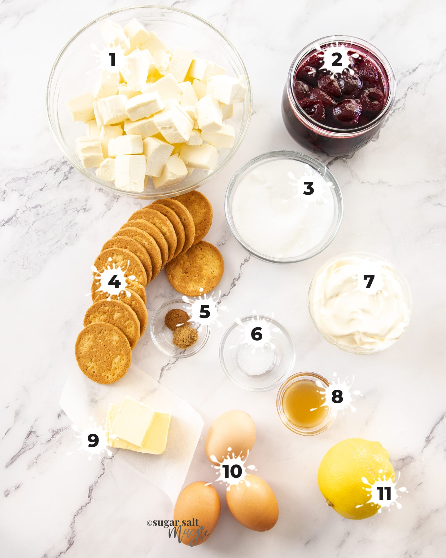 Ingredients for baked cherry cheesecake on a marble surface
