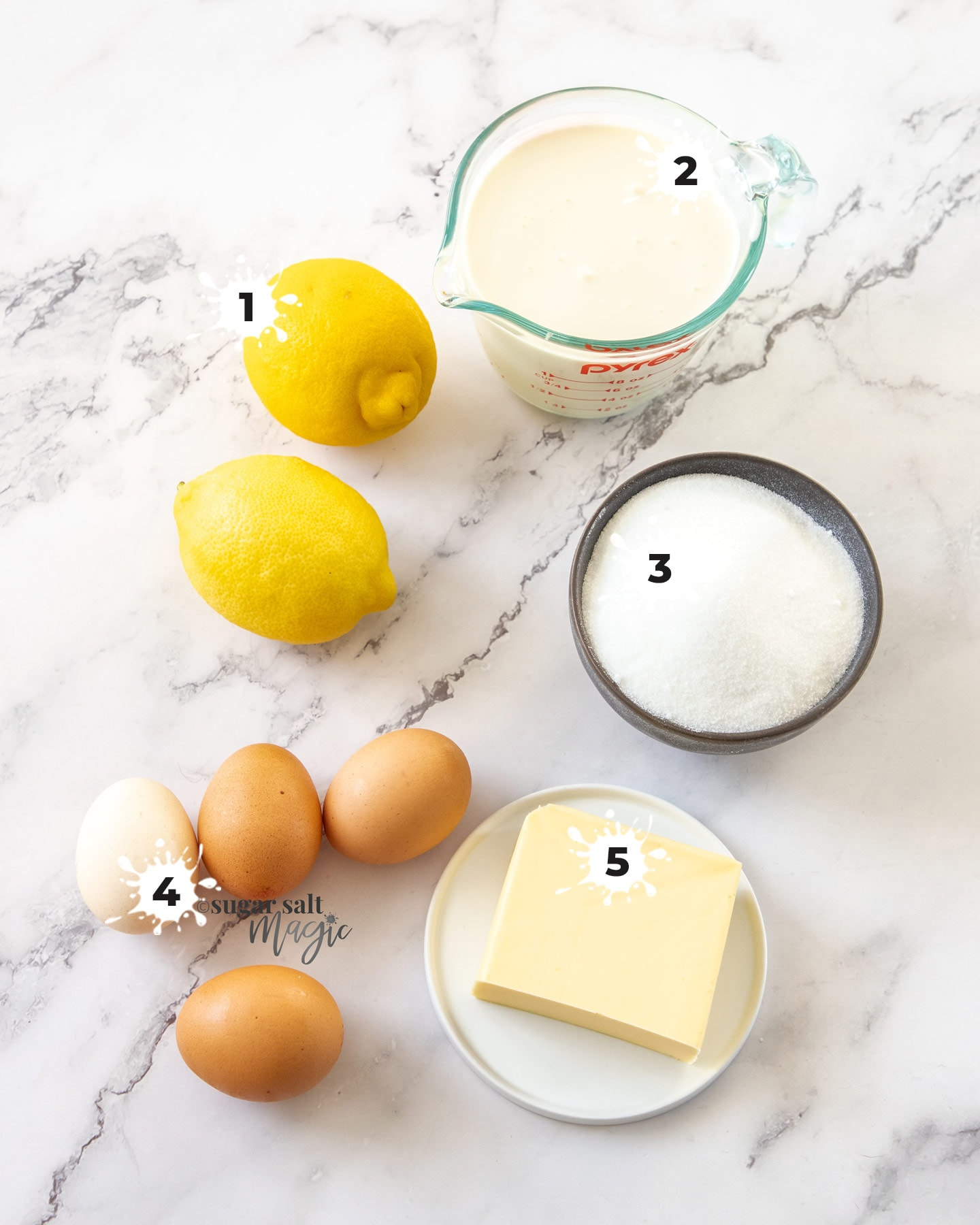 Ingredients for lemon mousse on a marble background