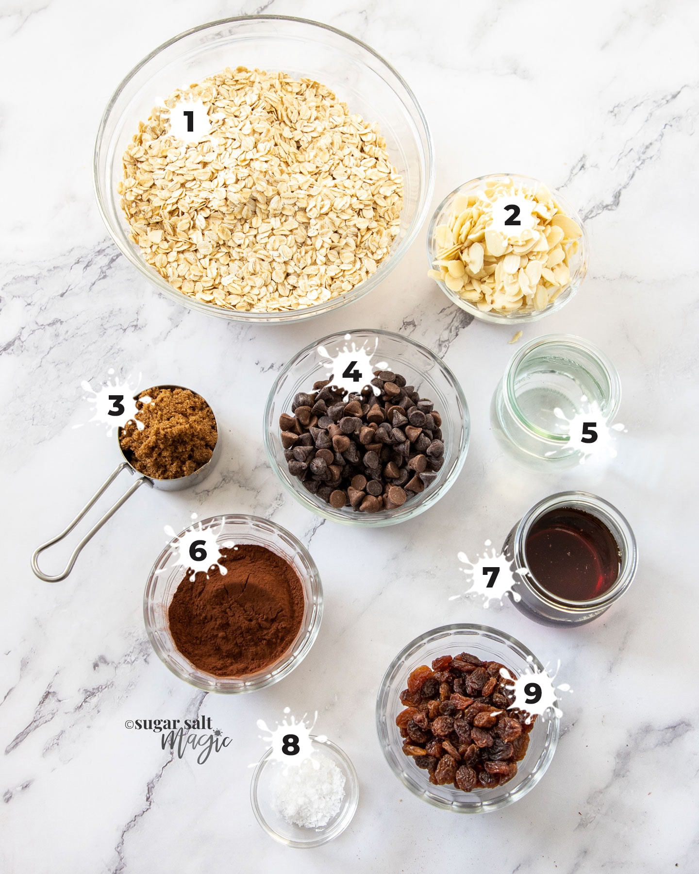Ingredients for chocolate granola on a marble bench top.