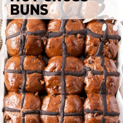9 chocolate hot cross buns still in the tray they were baked in.