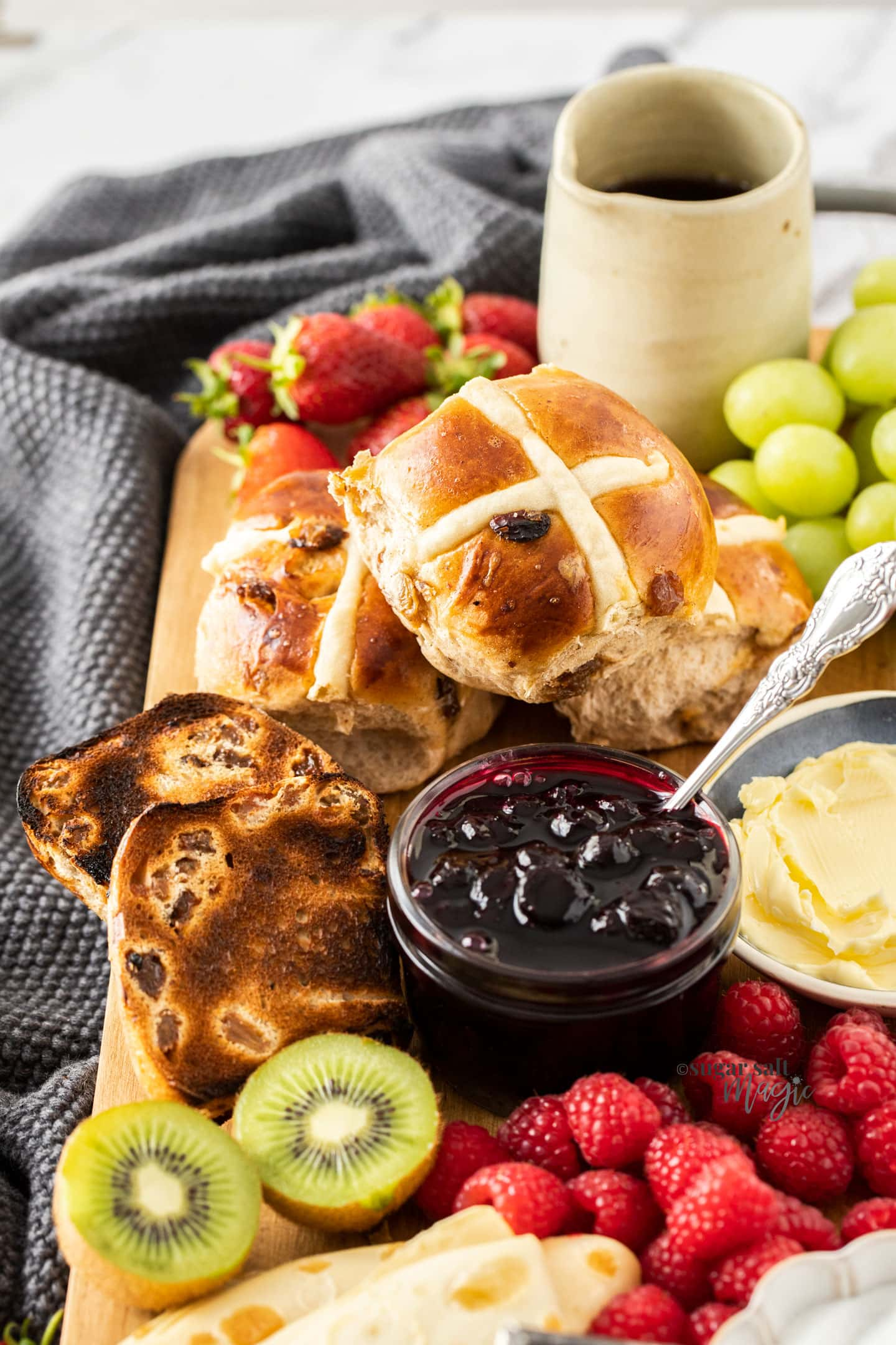Hot cross buns on a breakfast platter.