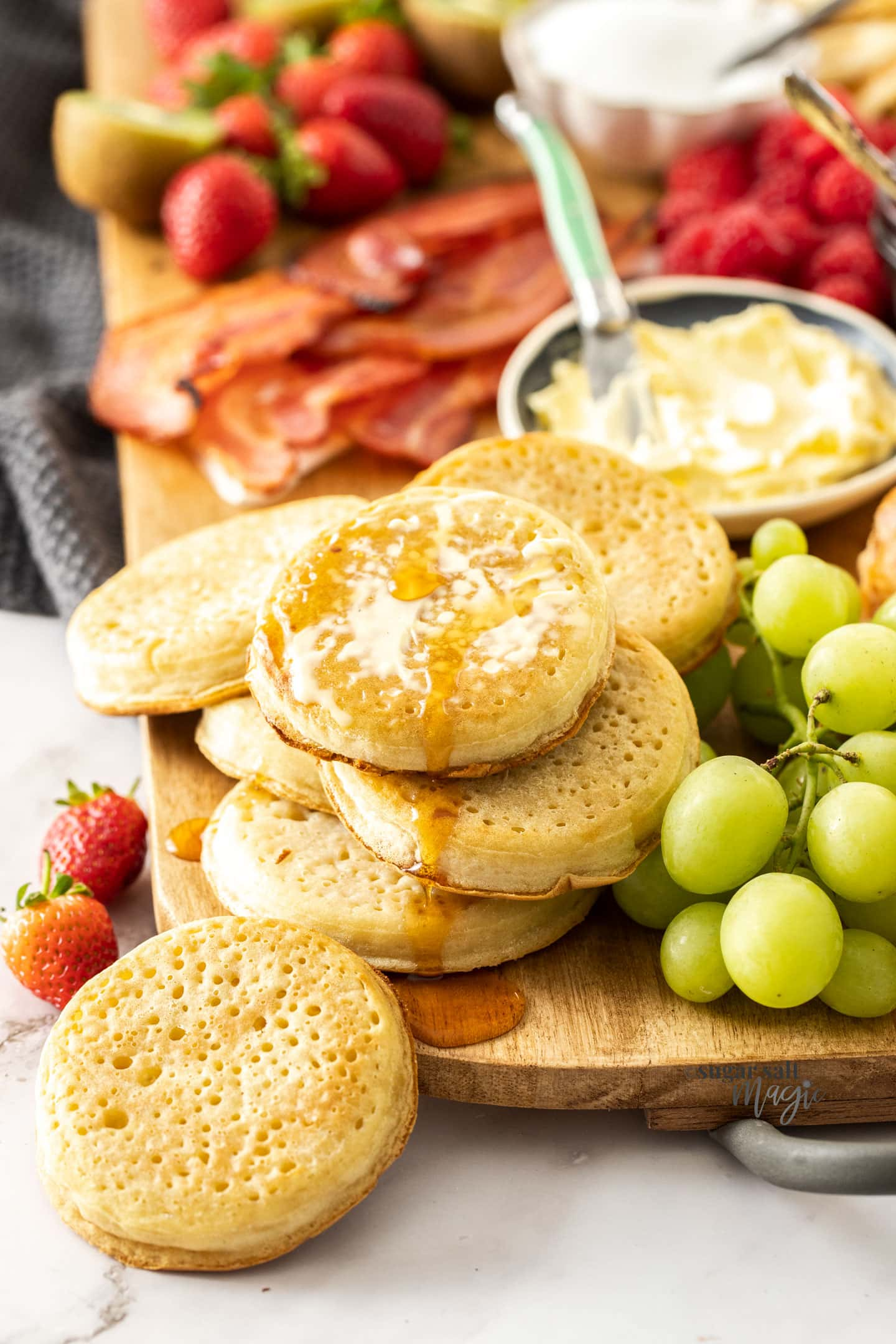 Crumpets dripping with butter and maple syrup.