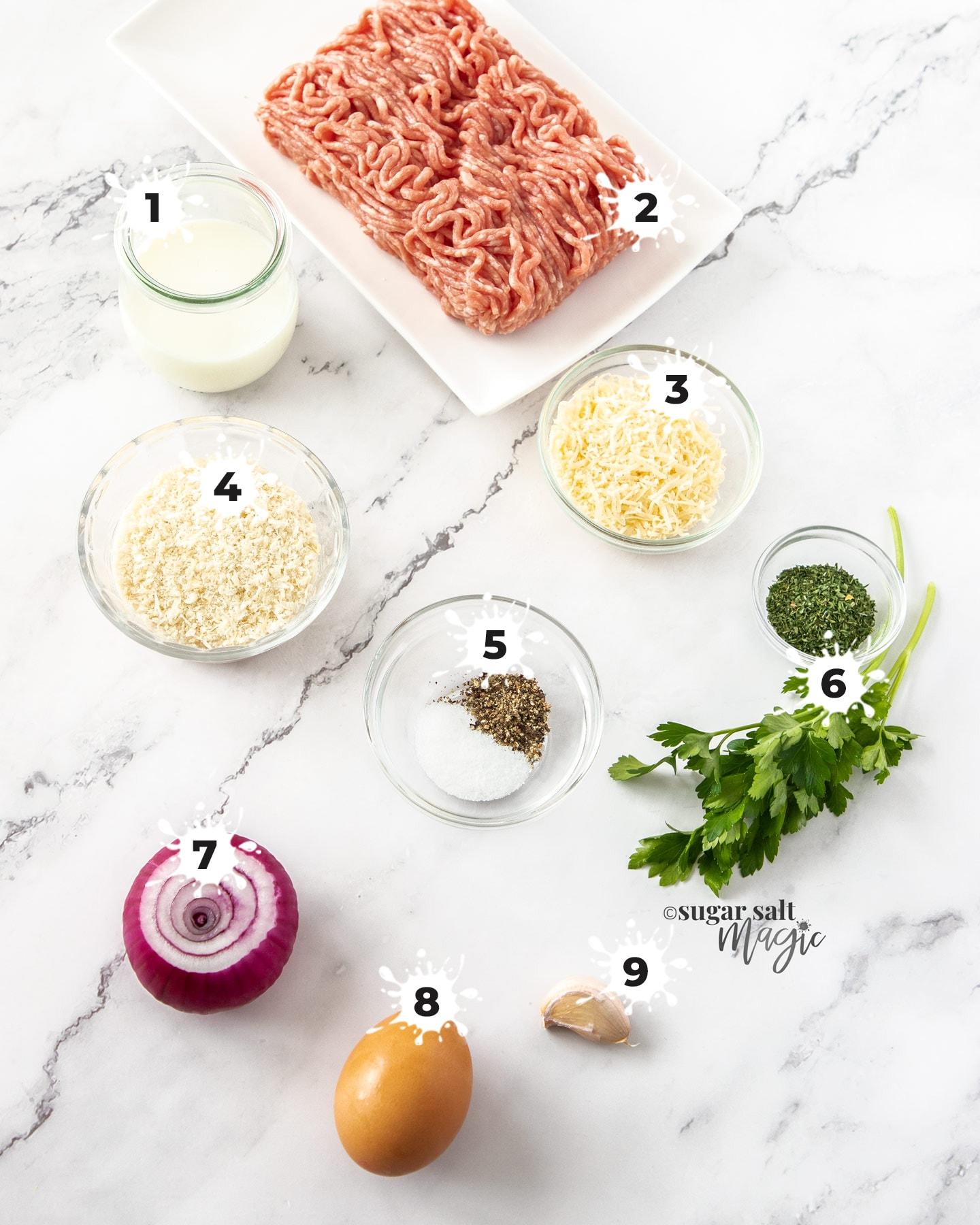 Ingredients for Italian meatballs on a marble worktop.