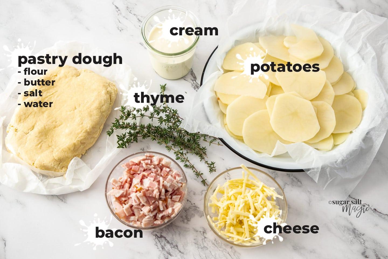 Ingredeints for bacon potato tart on a marble background.