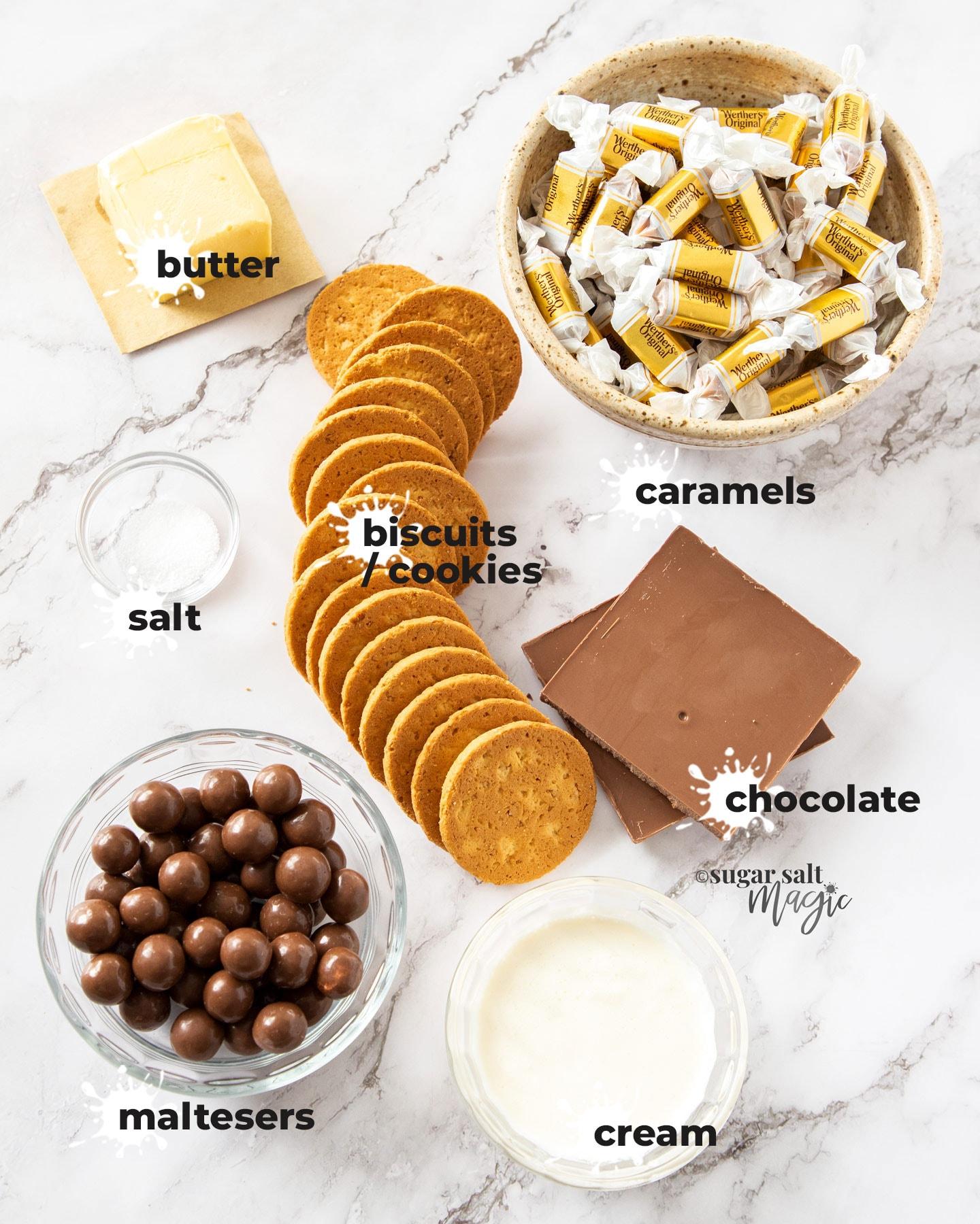 Ingredients for caramel malteser slice on a marble benchtop.