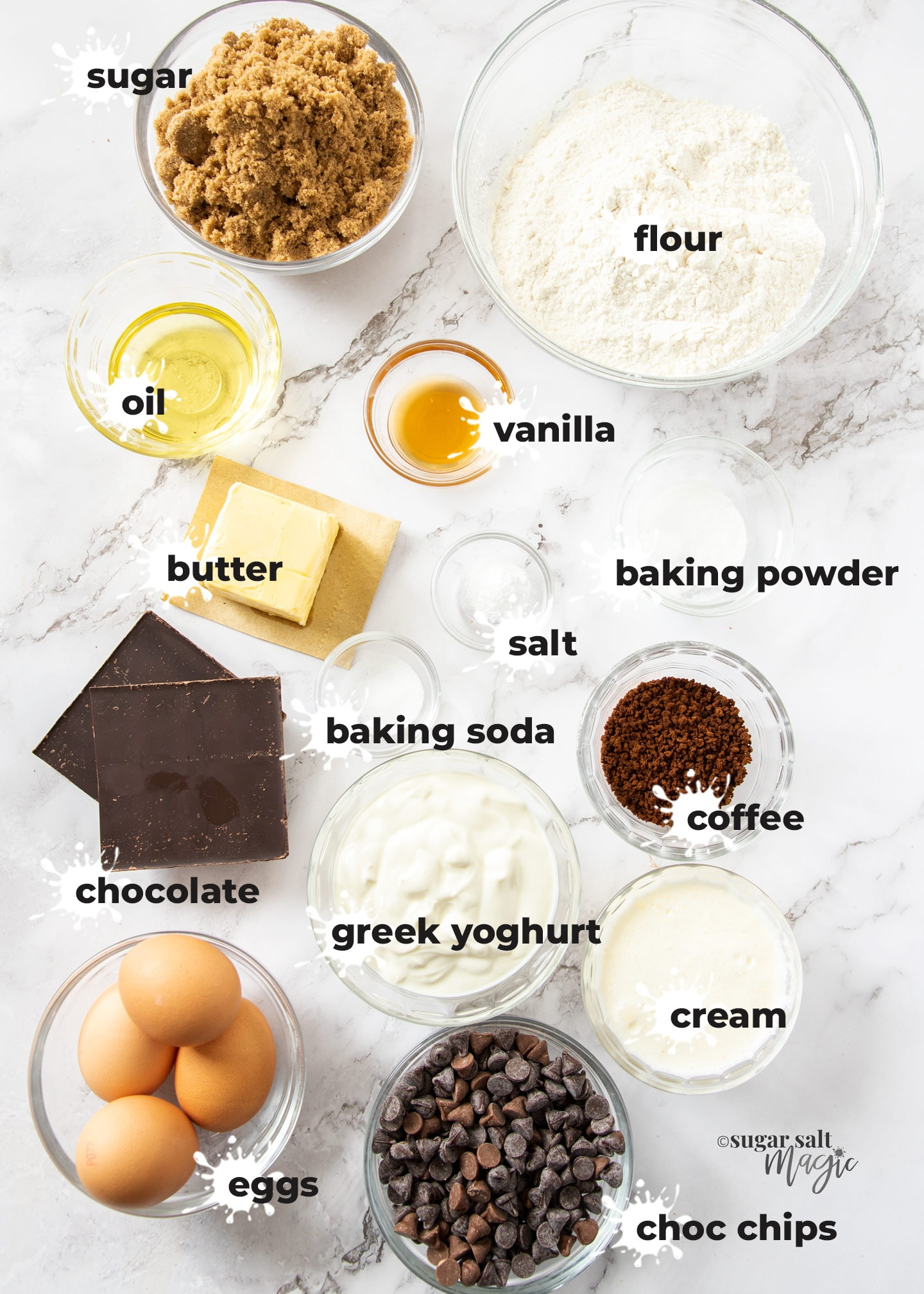 Ingredients for coffee bundt cake on a marble surface.