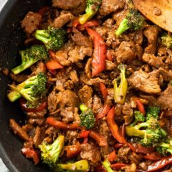 A black pan filled with pork stir fry.