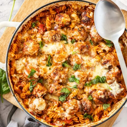 Top down view of a white casserole dish filled with meatball pasta bake.