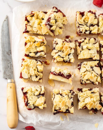 A batch of shortbread bars on a sheet of baking paper.