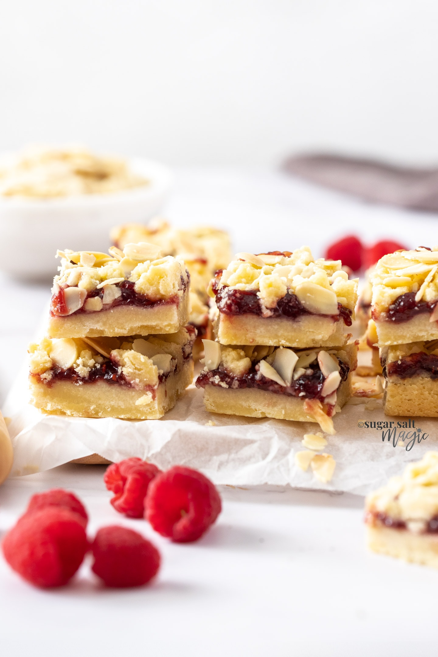 Stacks of shortbread bars, filled with jam.