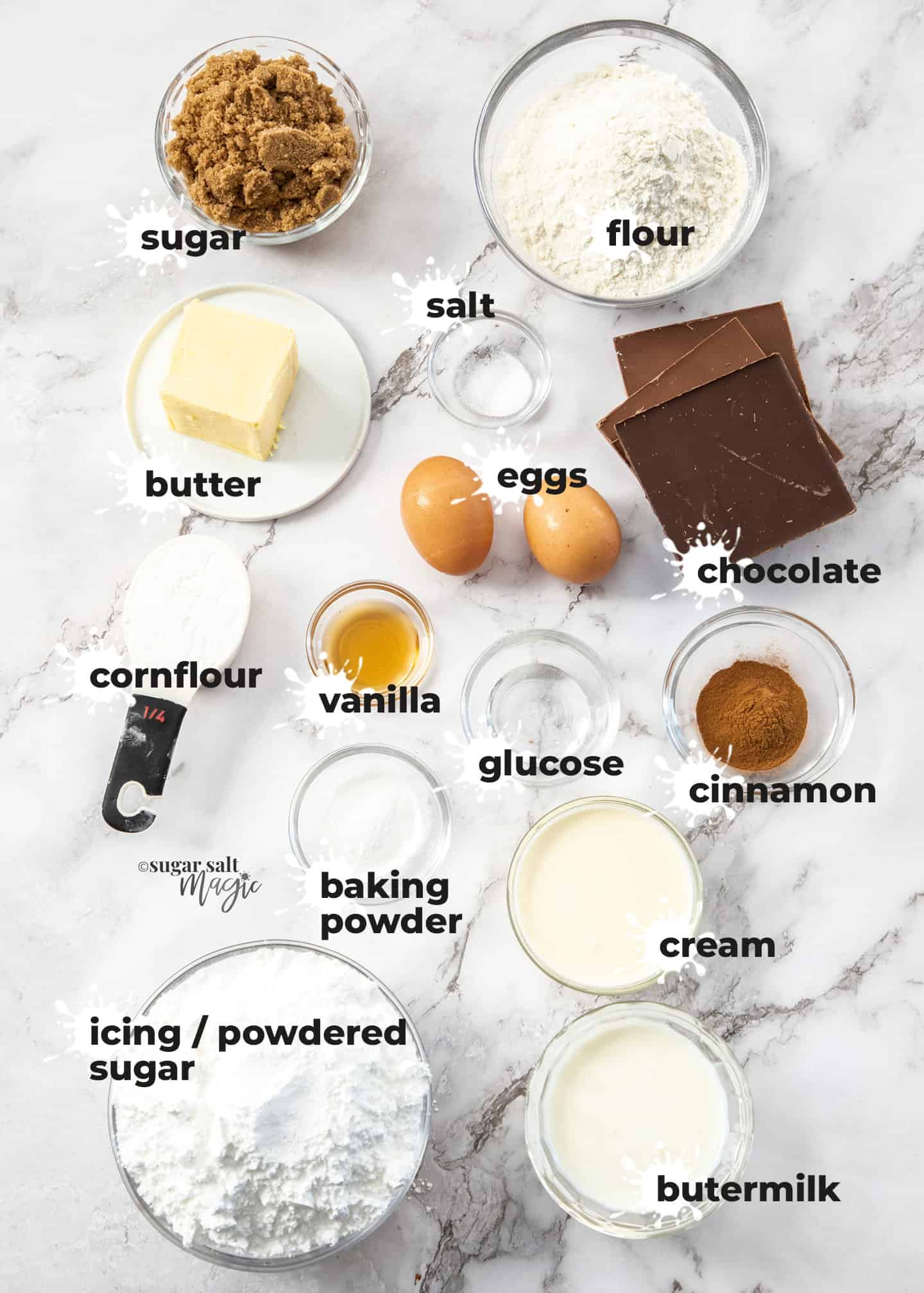 Ingredients for chocolate doughnut cupcakes on a marble benchtop.