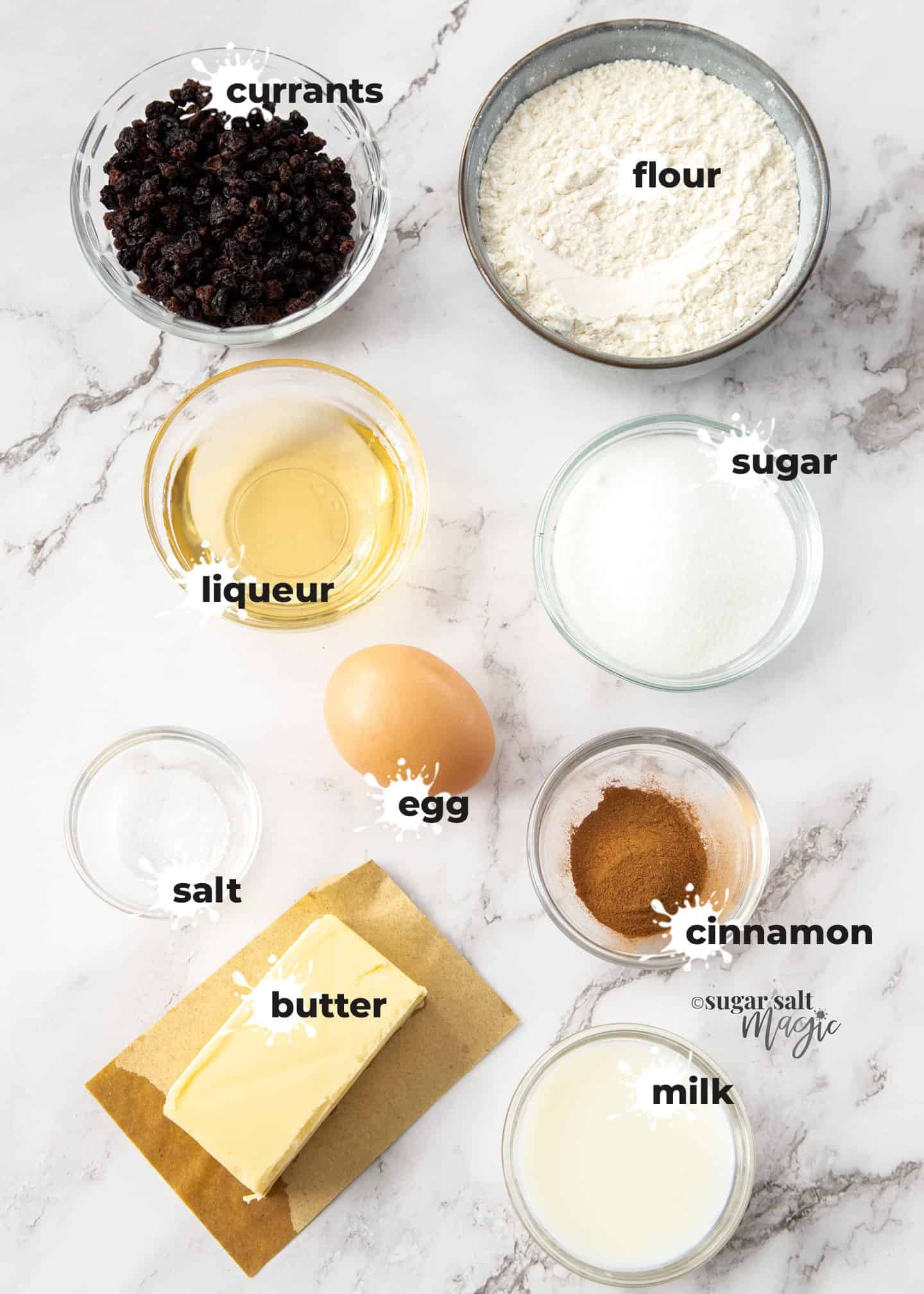 Ingredients set out in glass bowls on a marble benchtop.